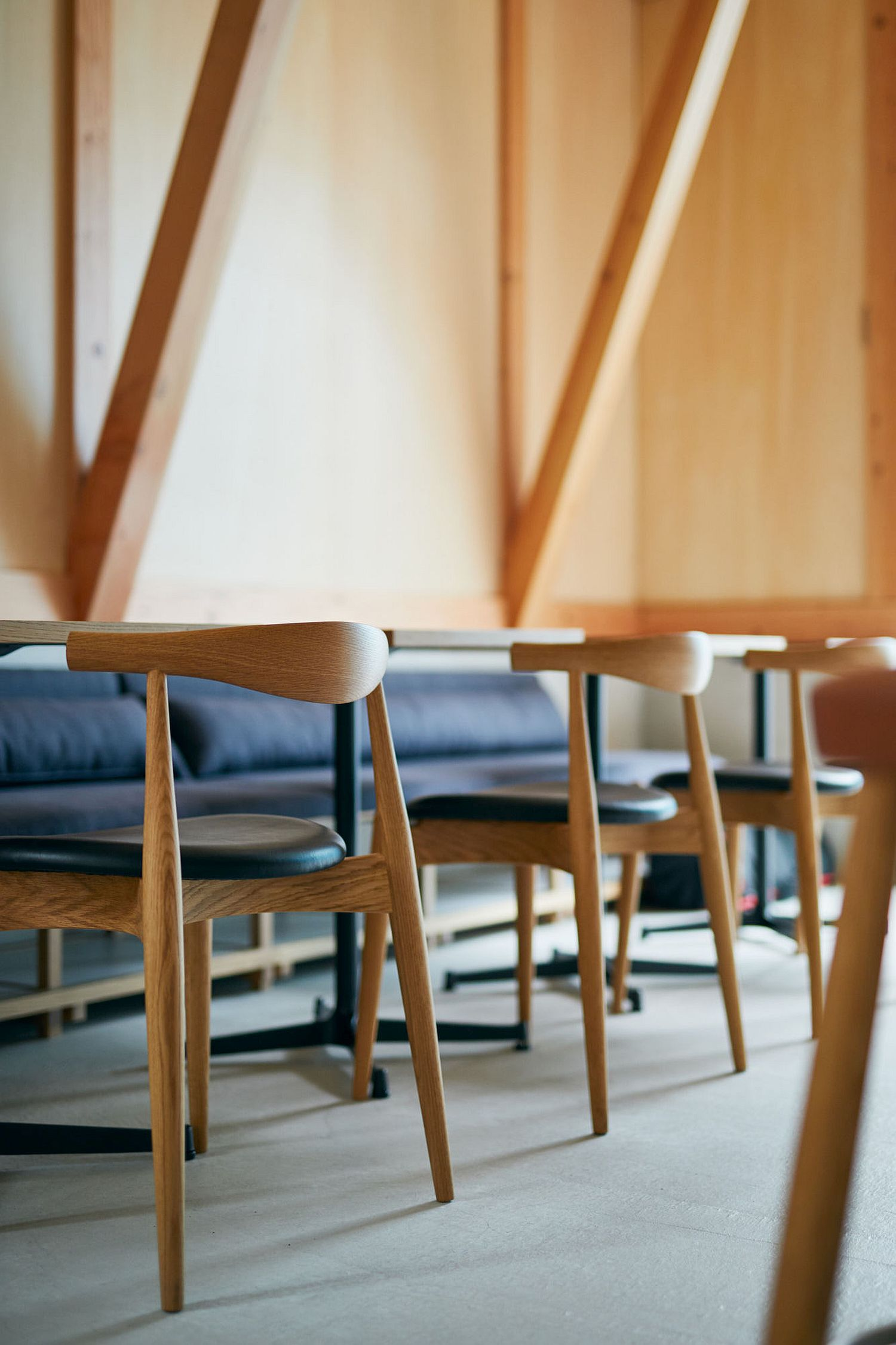 Wooden-stools-inside-the-cafe-add-to-its-minimal-Japanese-style
