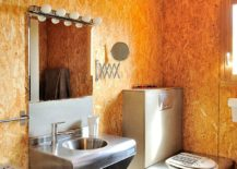 Awesome-textured-bathroom-walls-bring-orange-glow-to-the-setting-217x155