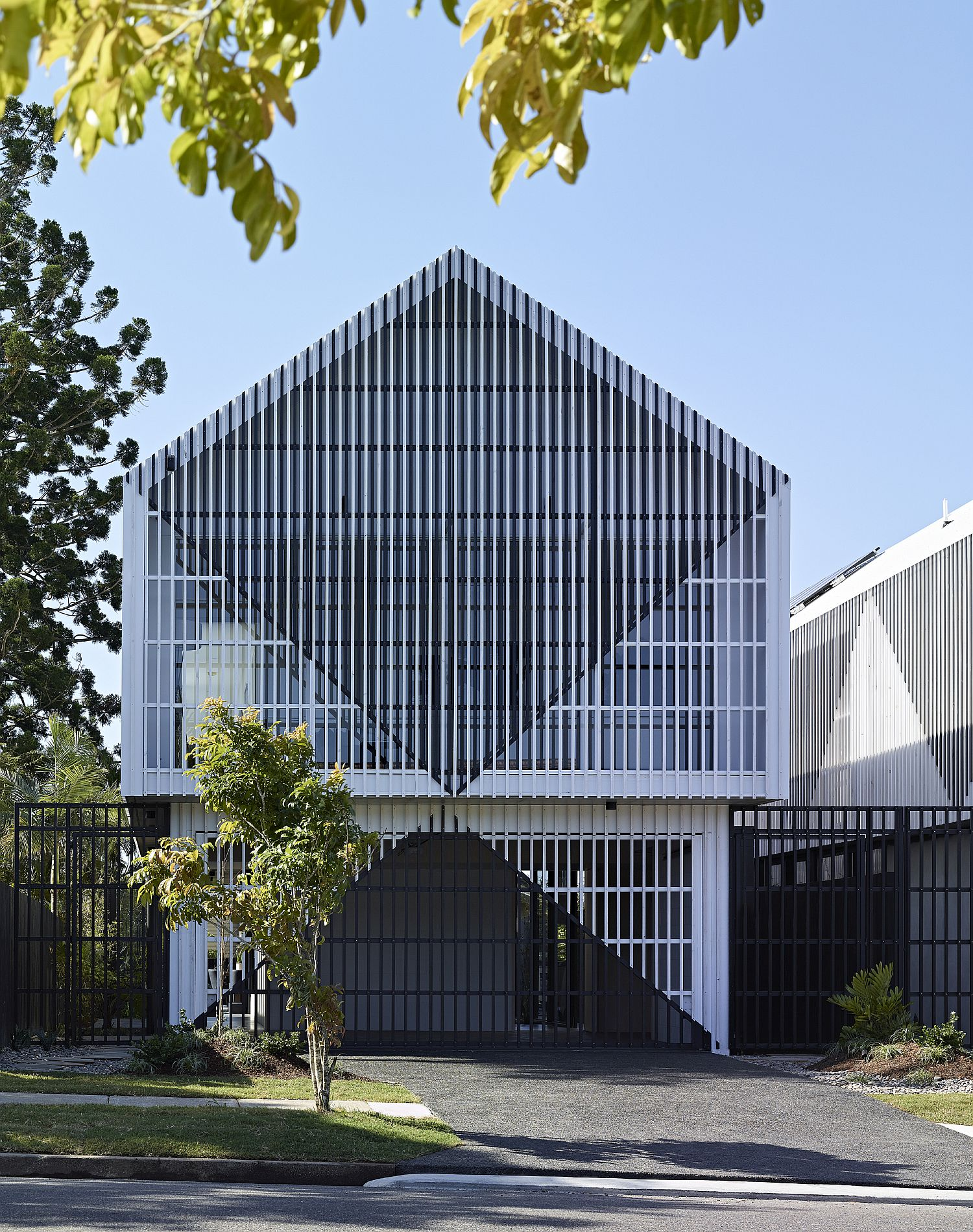 Batten-screened façade of the house offers the right amount of privacy