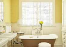 Beautiful-and-cozy-bathroom-in-yellow-and-white-with-transitional-style-217x155