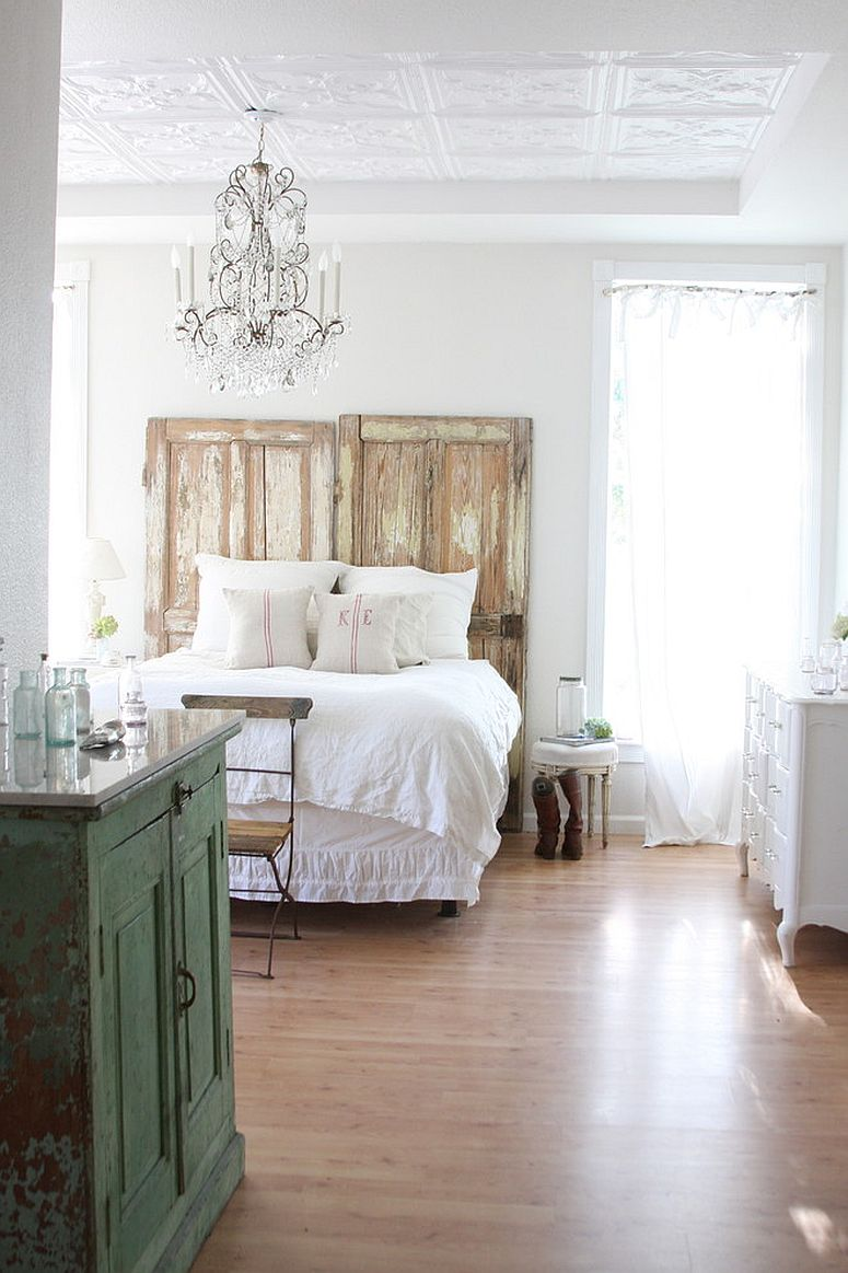 Beautiful bedroom in white with wooden decor in distressed finish