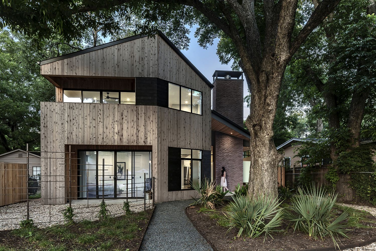 Beautiful cedar elm exterior of the Hewn House feels warm and inviting