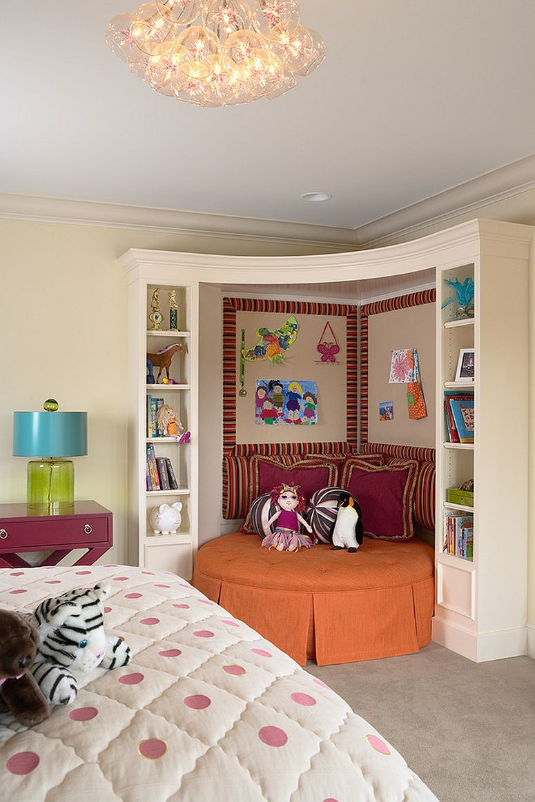 Beautiful round daybed in the corner with bookshelves all around