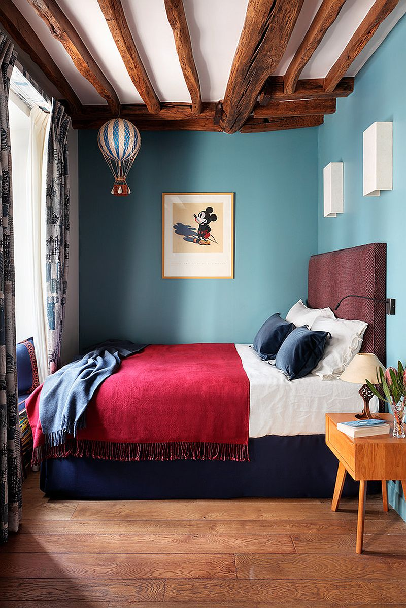 Beautiful use of color in the small eclectic London bedroom