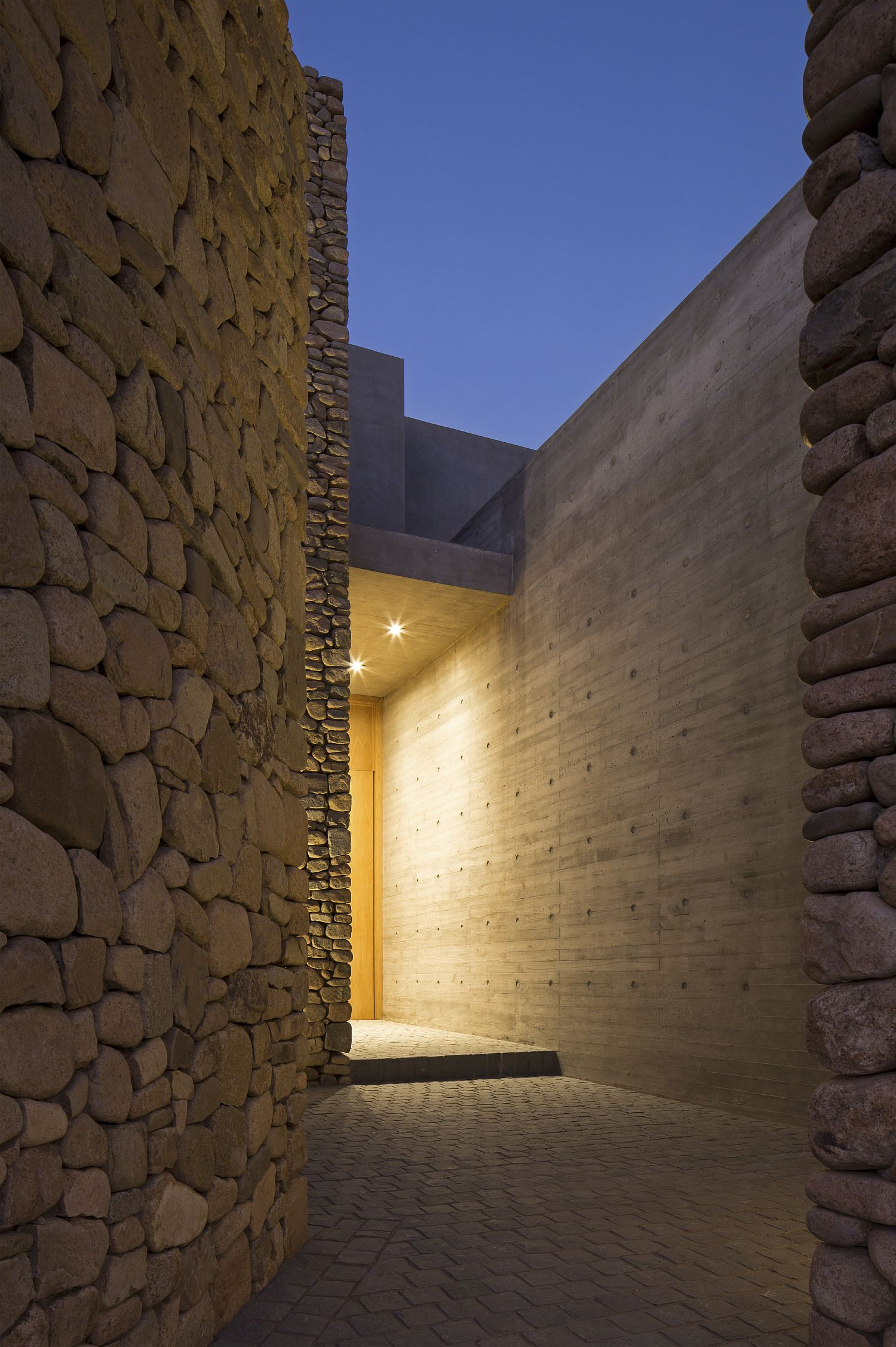 Beautiful wood, concrete and stone entrance of home in Lo Barnechea, Chile