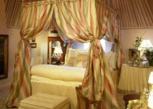 Bedroom-of-the-New-York-home-with-a-canopy-bed-and-a-dash-of-color-217x155