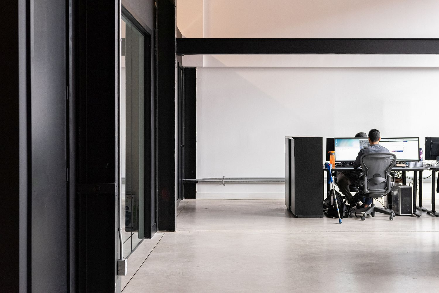 Black anchors the open plan office space beautifully