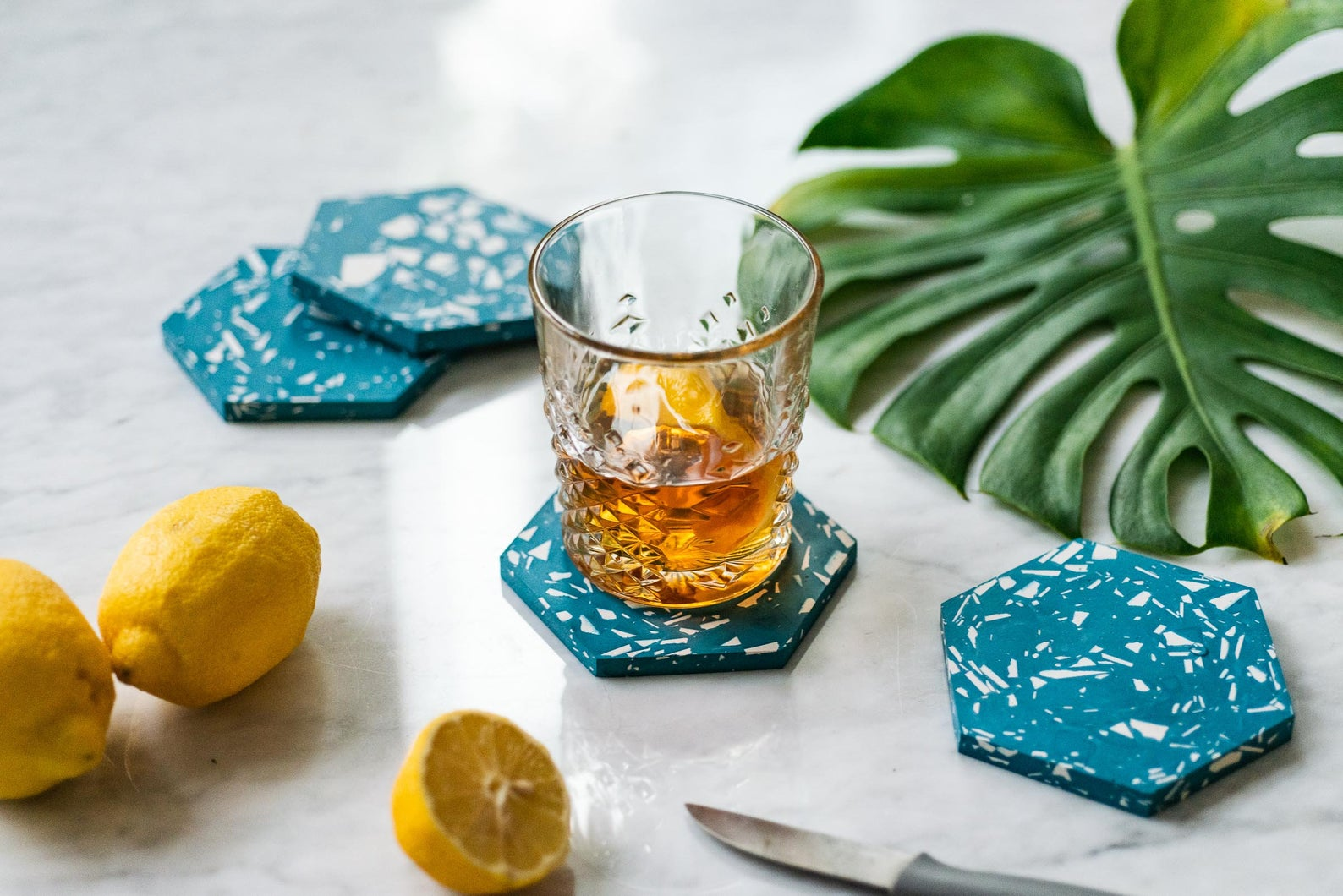 Blue hexagon coasters from Etsy shop Speckl Goods
