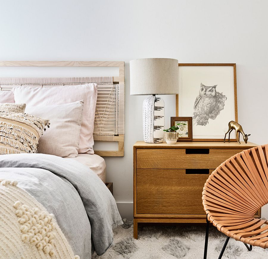 Bright Scandinavian style bedroom in white with wooden decor
