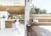 Built-in-seats-on-either-side-connect-the-kitchen-with-the-deck-outside-217x155