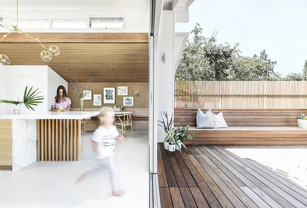 Built-in-seats-on-either-side-connect-the-kitchen-with-the-deck-outside