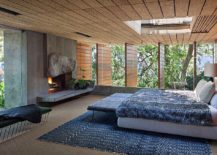 Ceiling-and-concrete-walls-give-the-modern-bedroom-a-different-visual-appeal-217x155