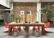 Chairs-in-red-add-color-to-an-otherwise-neutral-dining-space-with-brick-wall-217x155