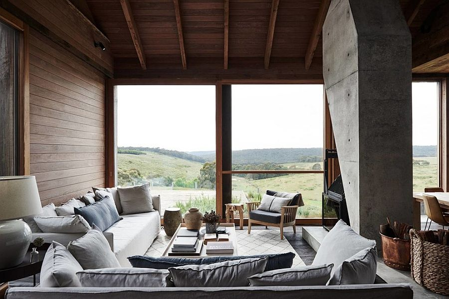Concrete fireplace structure in the living room makes a big visual impact