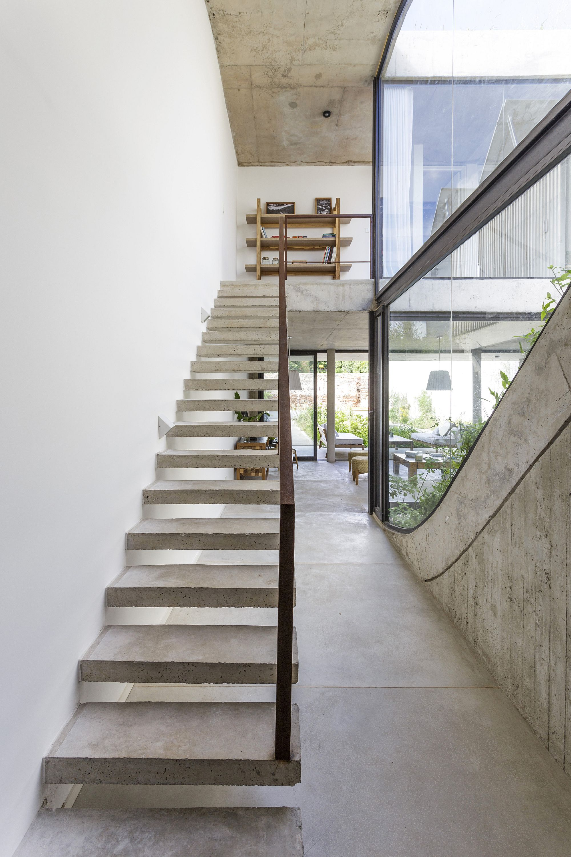 Concrete staircase with steel railing leads to the top level