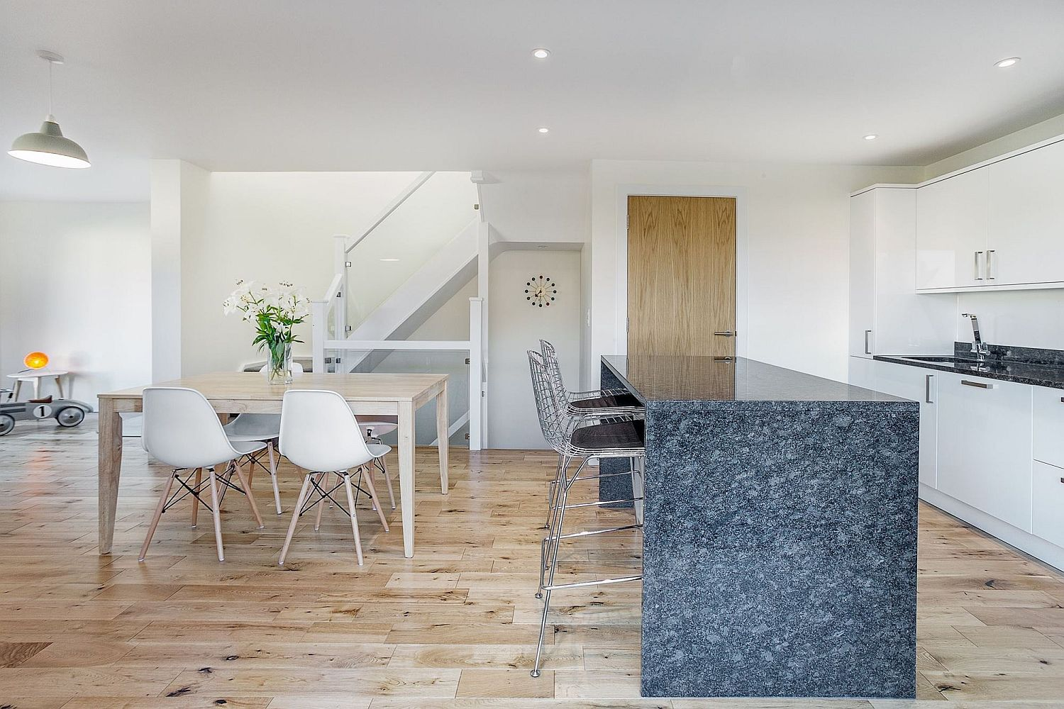 Contemporary interior of the homes in white and wood with smart stone island