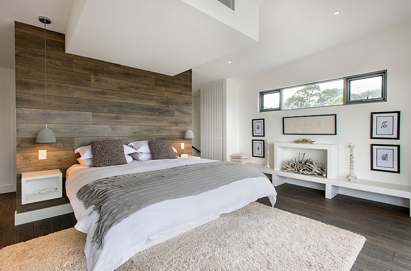 Creating a lovely textured wooden accent wall using reclaimed wood in the bedroom