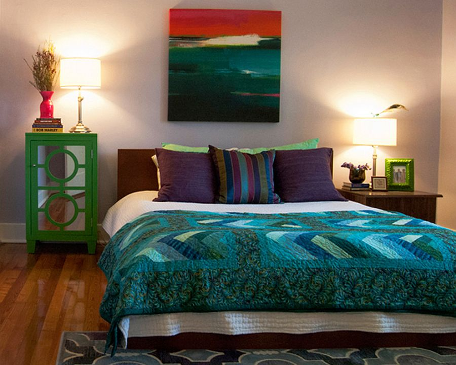 Curated decor pieces, bedding and art work add color to this bedroom