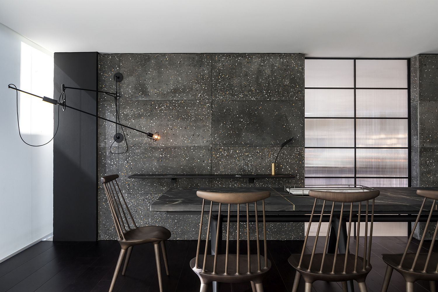 Dark and dashing backdrop of the dining room crafted using Tresuno's concrete
