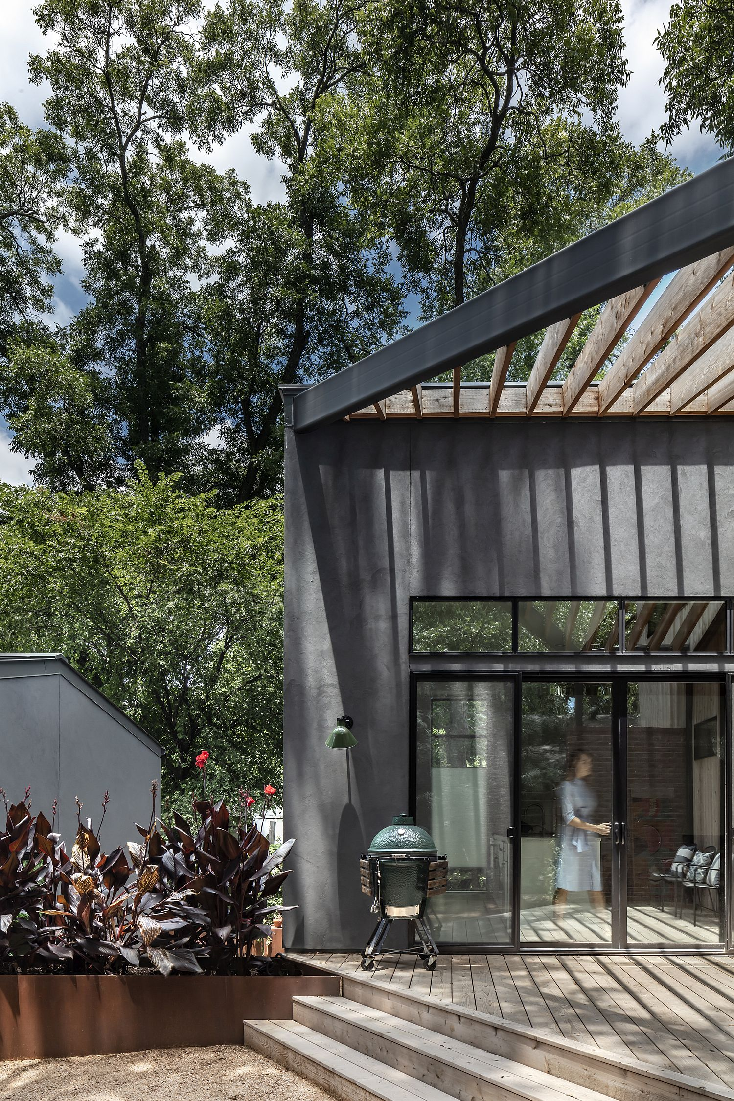 Dark gray stucco gives modernity to the exterior of the house