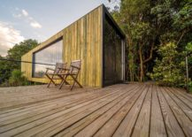 Deck-and-outdoors-of-the-cain-draped-in-wood-and-surrounded-by-greenery-217x155