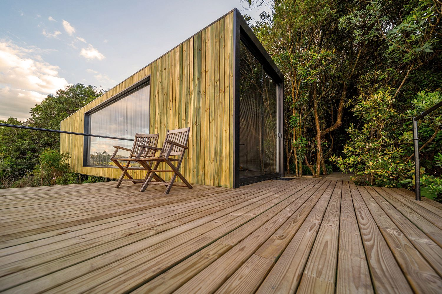 Deck-and-outdoors-of-the-cain-draped-in-wood-and-surrounded-by-greenery