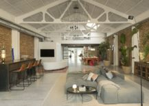 Delightful-vaulted-ceiling-in-white-adds-contemporary-appeal-to-the-industrial-loft-217x155