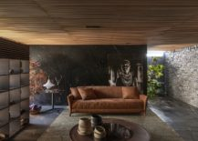 Earthen-tones-wood-and-dark-stone-combined-beautifully-in-the-living-room-217x155