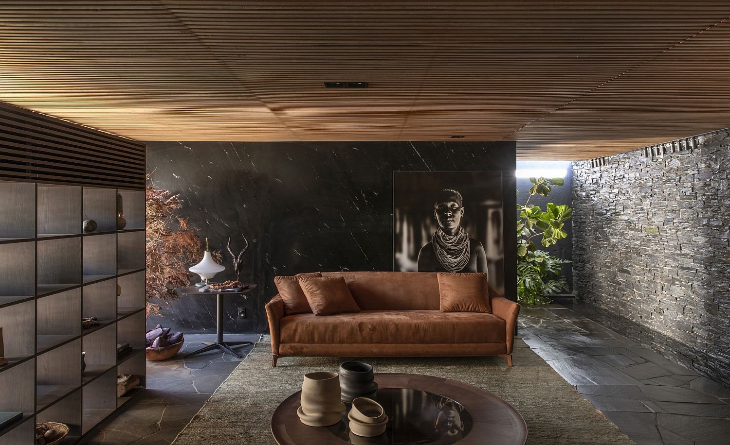 Earthen tones, wood and dark stone combined beautifully in the living room