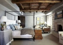 Fabulous-Mediterranean-bedroom-with-wooden-ceiling-concrete-walls-and-four-poster-bed-217x155