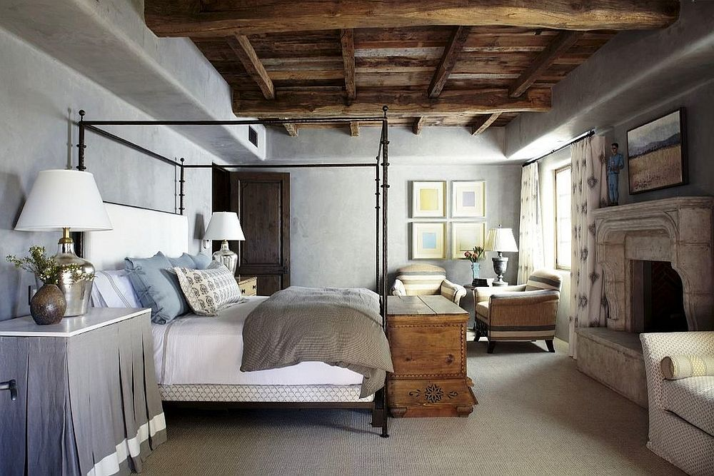 Fabulous Mediterranean bedroom with wooden ceiling, concrete walls and four poster bed