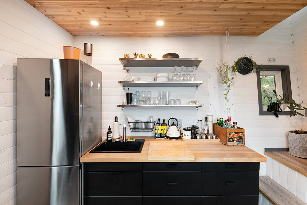 Fitting appliances and storage containes into the design plan of the tiny kitchen