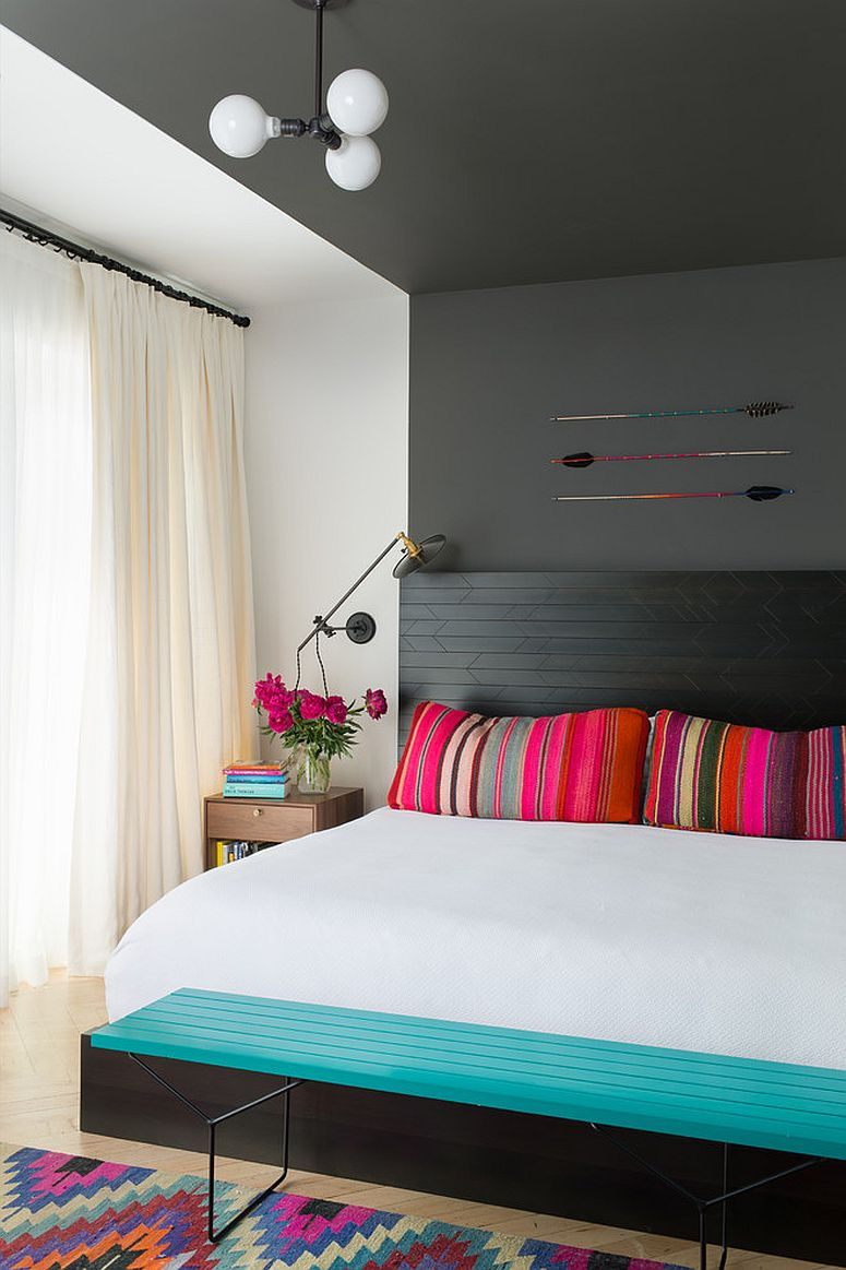 Fun and easy way to add color to the neutral bedroom with throw pilows and rugs