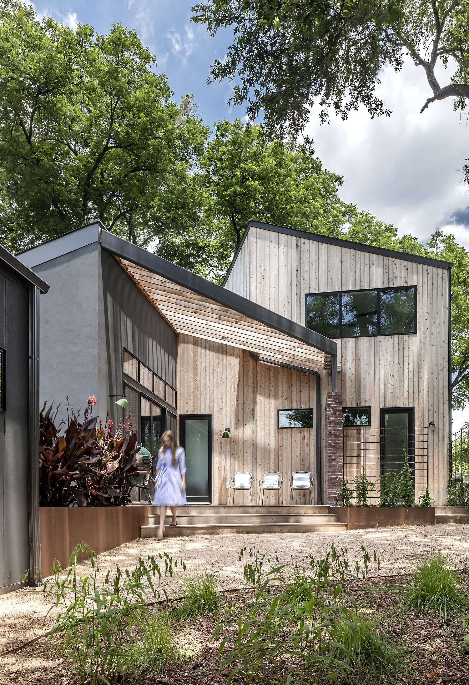 Gable roof and wood exterior give the home a modern cabin look