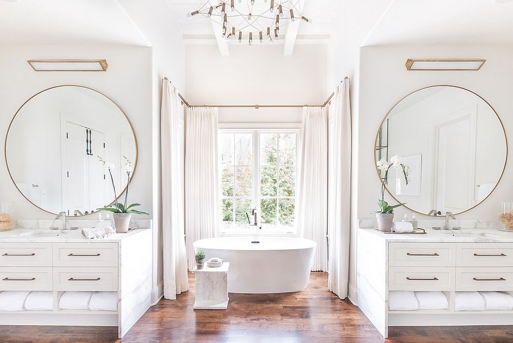 Gorgeous-white-bathroom-with-twin-vanities-round-mirrors-and-metallic-accents