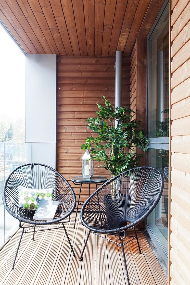 Iconic Acupulco chairs for the small modern balcony with a hint of green