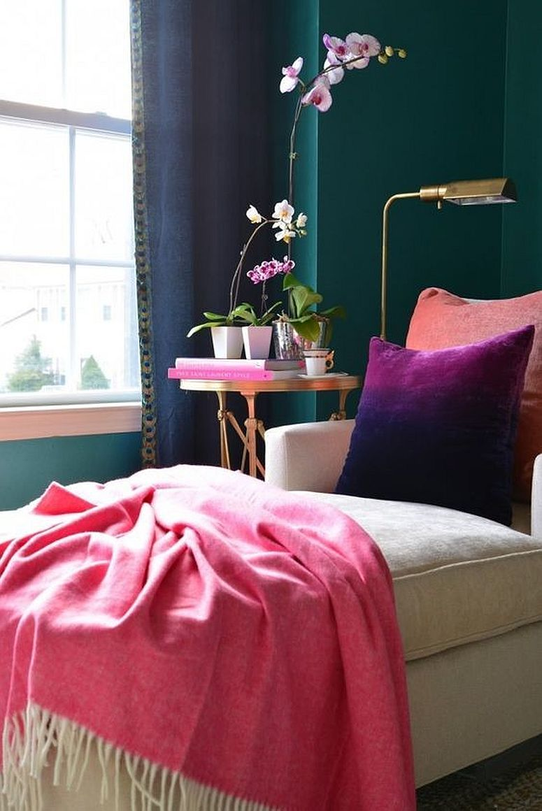 Jewel-toned walls in the bedroom coupled with other bright colors