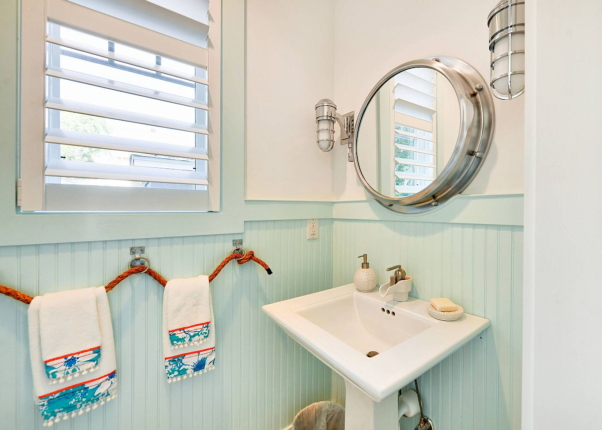 Light blue and white powder room with beach style and innovative rope towel hangers