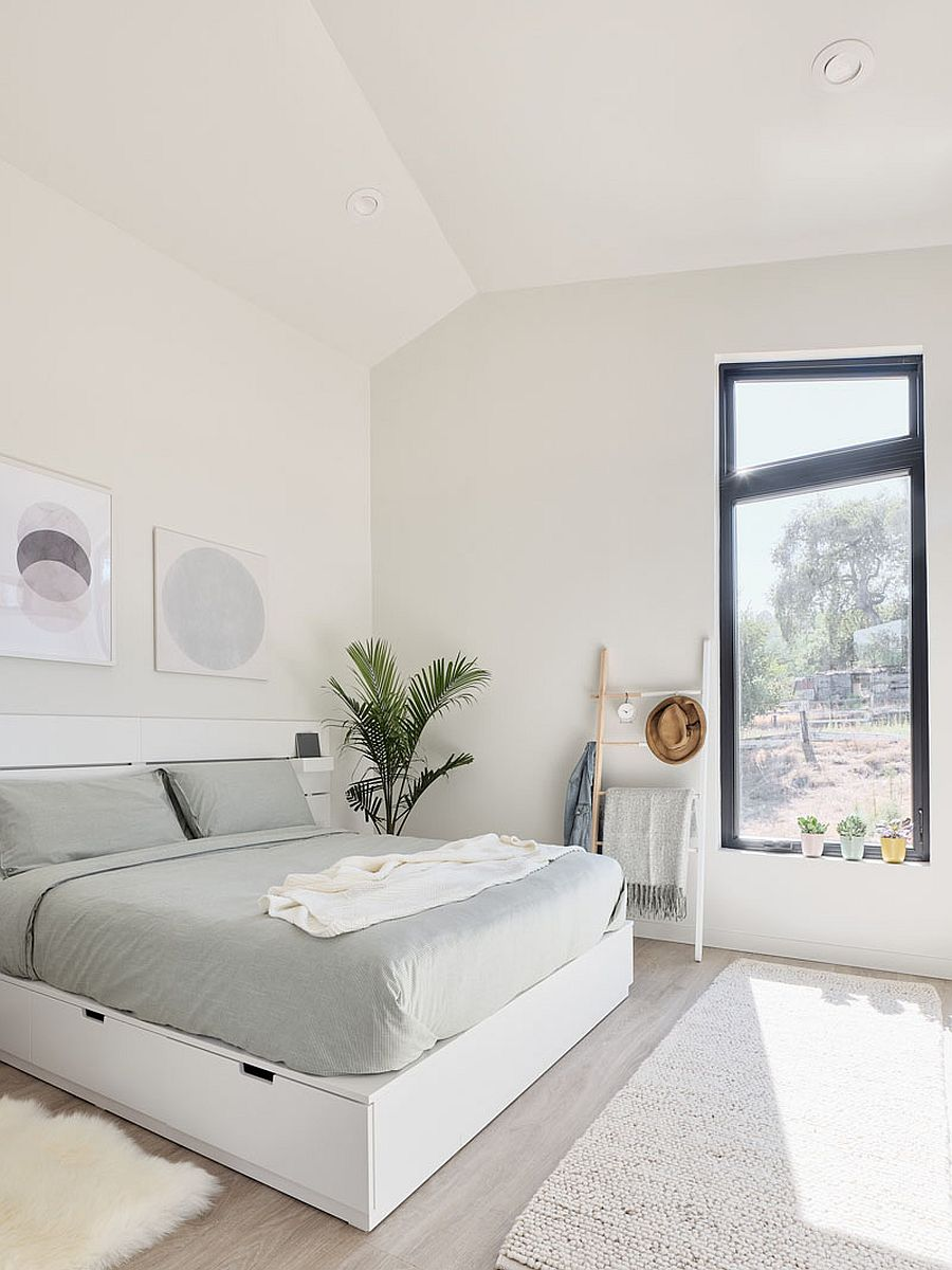 Light-filled-and-white-bedroom-with-vaulted-ceiling