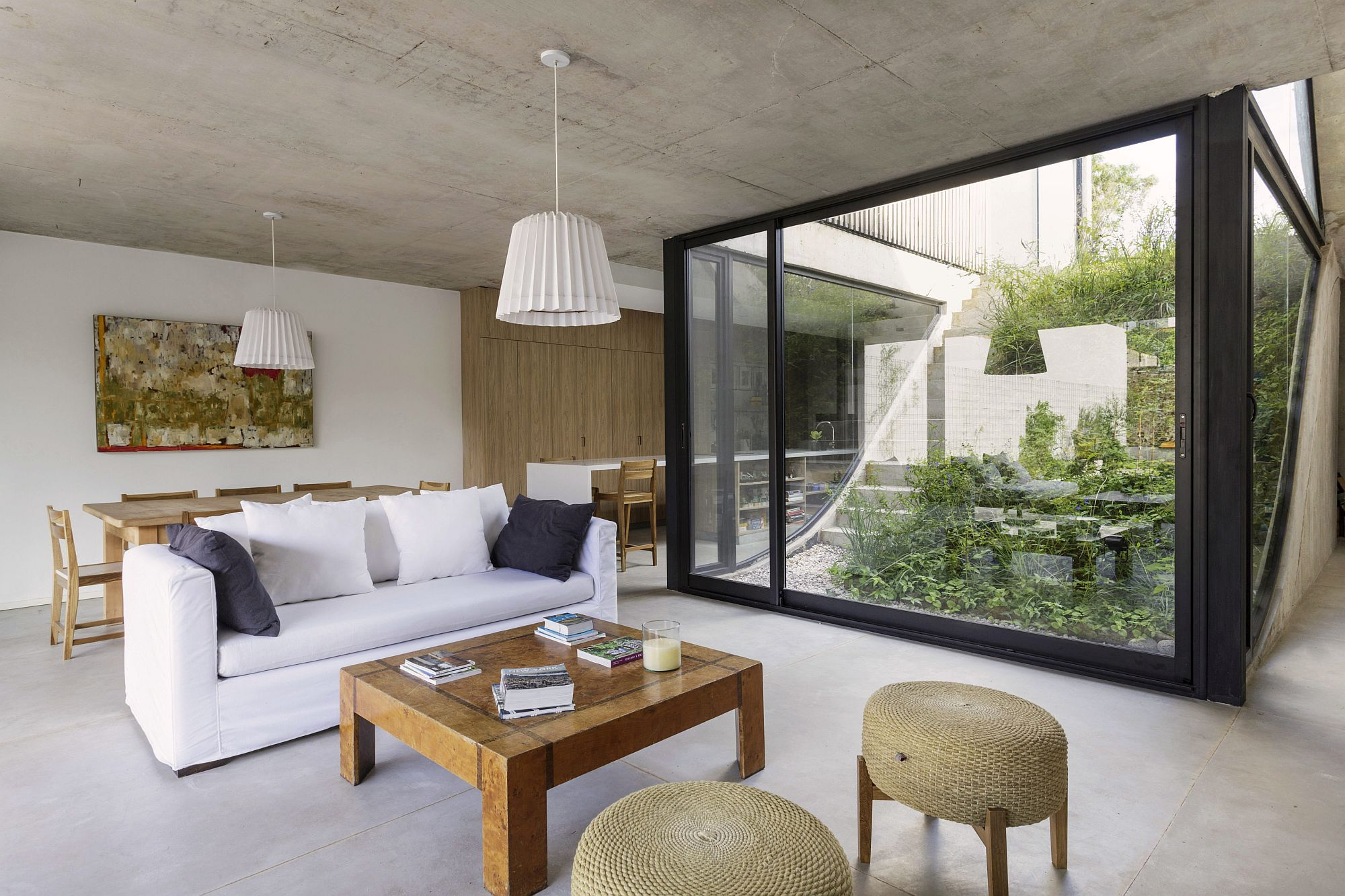 Living room of the house in white and wood with plenty of natural light flowing in