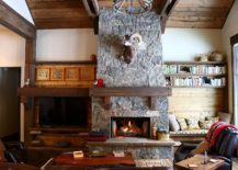 Lovely-stone-fireplace-is-a-staple-in-the-rustic-living-room-that-never-fails-to-impress-217x155