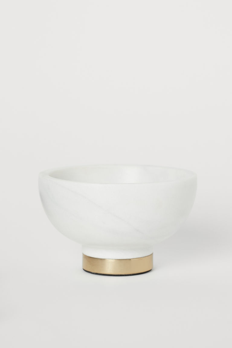 Marble bowl with a metal base