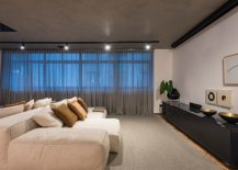 Minimal-and-stylish-bedroom-with-concrete-ceiling-and-neutral-color-scheme-217x155