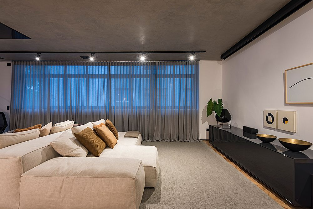 Minimal-and-stylish-bedroom-with-concrete-ceiling-and-neutral-color-scheme