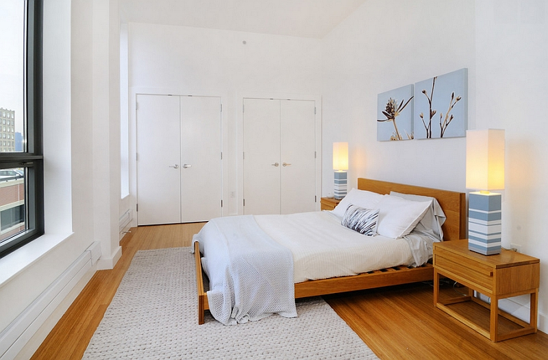 Modern minimal bedroom with a simple wood and white color scheme