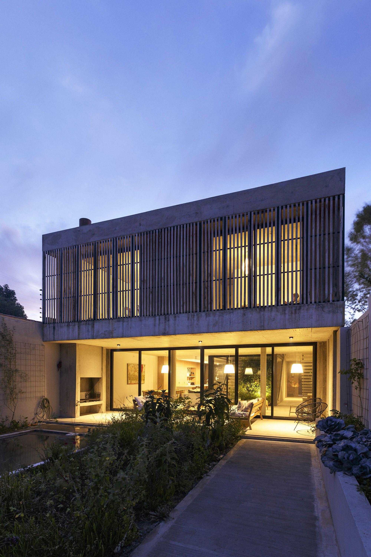 Modern rear facade of the house opens up into the garden