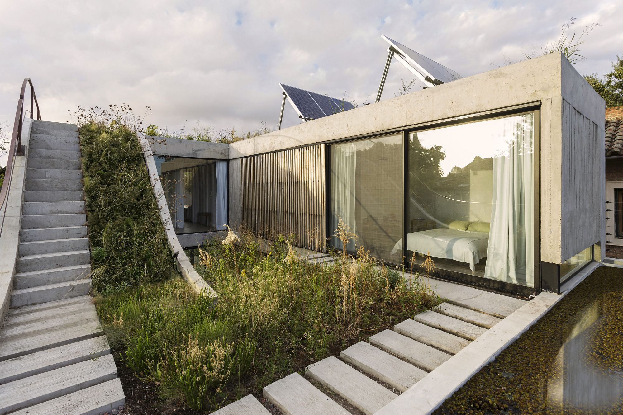 Multi-level garden across the house adds eco-friendly appeal to the setting