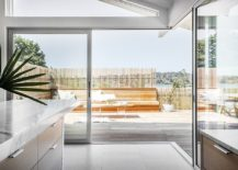 Multi-sliding-doors-with-aluminum-frames-connect-the-kitchen-and-dining-space-with-deck-outside-217x155