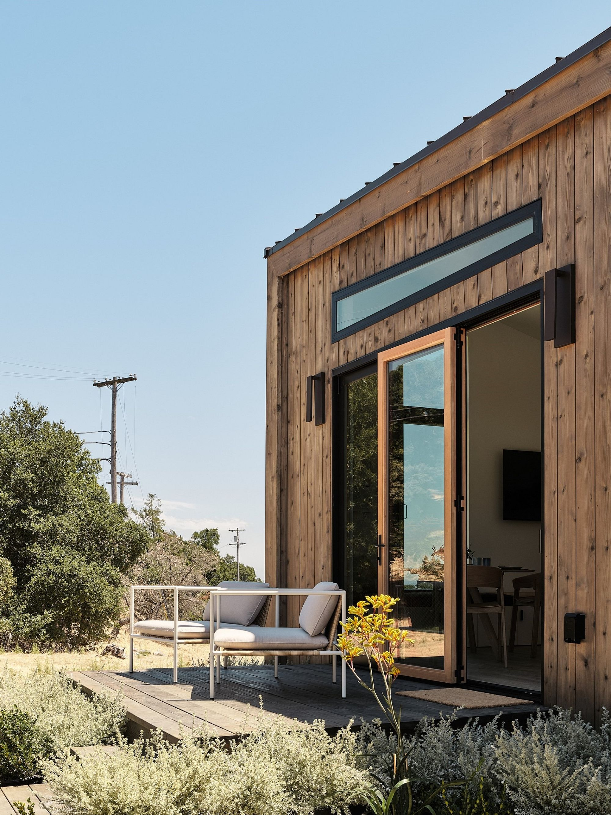 Naturally-stained cedar siding shapes the exterior of the house