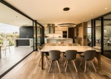 Open-plan-living-area-of-the-housewith-outdoor-kitchen-and-dining-next-to-it-217x155